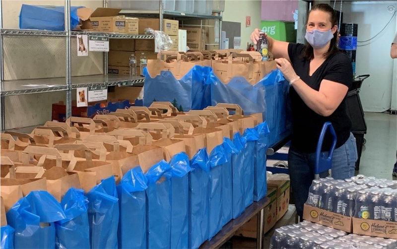 Volunteer filling food bags
